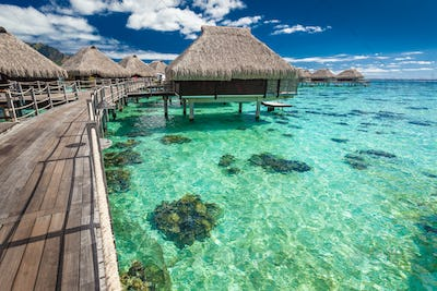 Over water villas on a tropical lagoon of Moorea Island, Tahiti