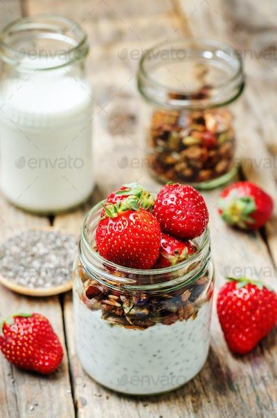 Chia seeds granola Greek yoghurt pudding with strawberries