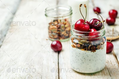 Chia seeds granola Greek yoghurt pudding with cherries