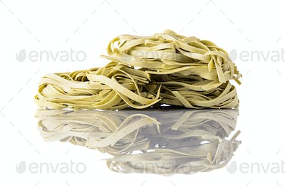 Green Tagliatelle Fettuccine Pasta on White Background