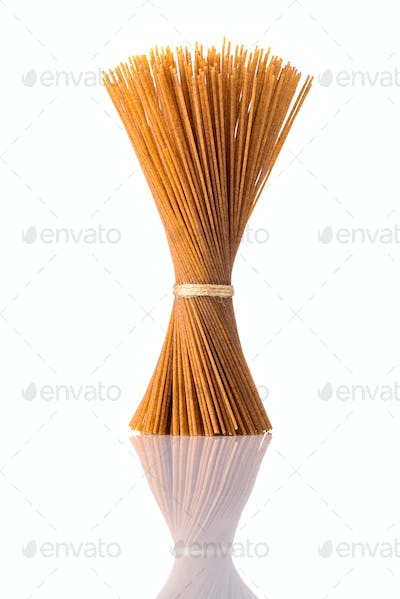 Brown Whole-Wheat Spagetti Pasta on Isolated White Background