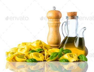 Yellow Tortellini with Salt and Olive Oil Isolated on White Back