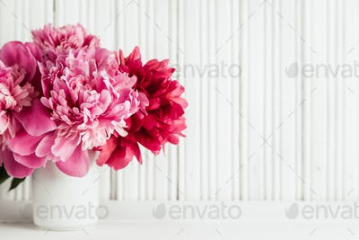 Mother day background with pink peonies flowers
