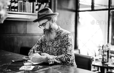 Senior Man Writing Working Coffee Shop Realxation Concept