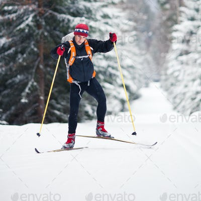 Cross-country skiing: young man cross-country skiing on a lovely