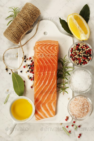 Delicious portion of fresh salmon fillet with aromatic herbs, sp