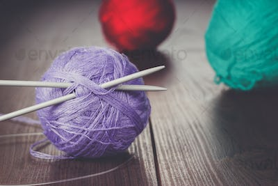 knitting needles and balls of threads