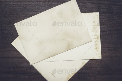 old sheets of paper on wooden table