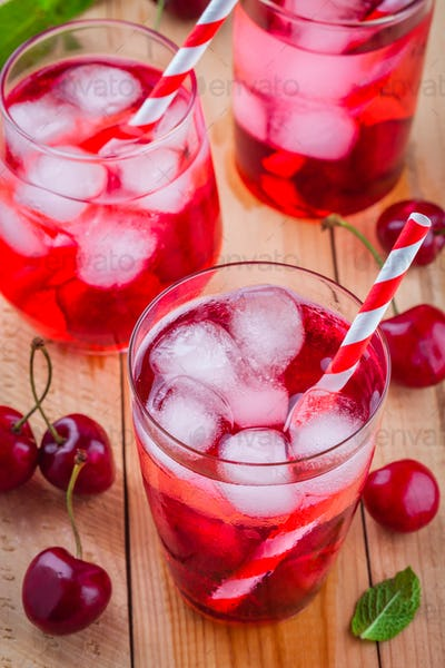 cherry lemonade with ice in glasses