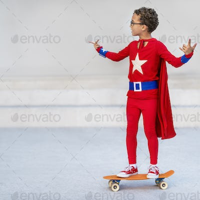 Superman Kid Playing Skateboard Cheerful Concept