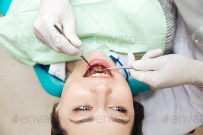 Close-up of patient open mouth during oral inspection
