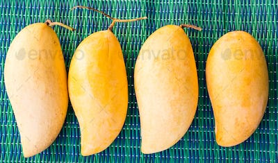 fruits, diet and healthy food concept - close up of mango