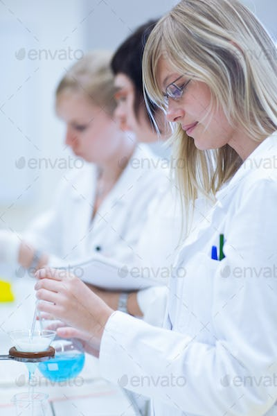 portrait of a female researcher carrying out research in a chemi