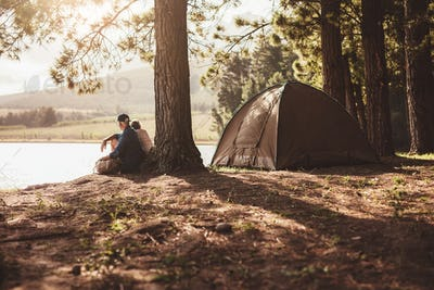 Mature couple camping by a lake