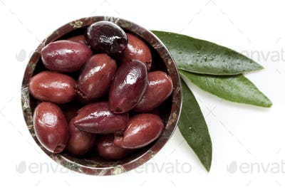 Pitted Black Kalamata Olives with Leaves Top View