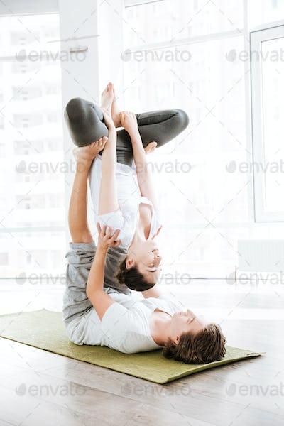 Young couple doing acro yoga