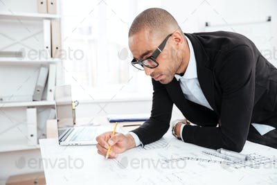 Close-up portrait of a businessman making notes at documents