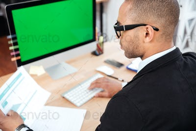 Businessman working with documents in office