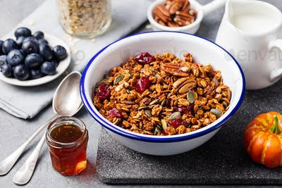 Healthy breakfast. Fresh granola, muesli with pumpkin,pecan nuts,cranberries and maple syrup