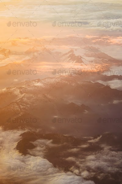 Sunset Over Mountains From Height Of Airplane. Bright Orange, Ye