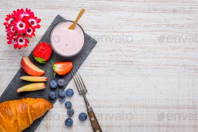 Yogurt and Croissant as Breakfast with Copy Space