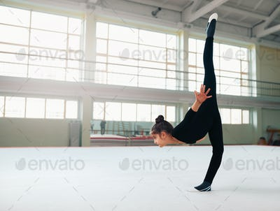 gymnast performs a balance with split.