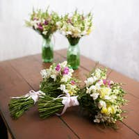 There are four wedding bouquets