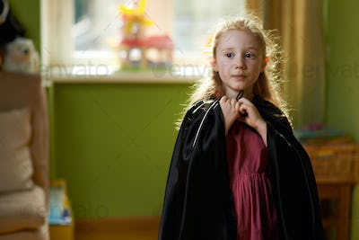 girl dresses black cape