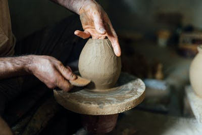 The man make vase from clay