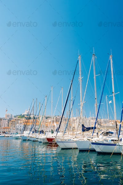 White Yachts Are Moored At City Pier, Jetty, Port In Marseille,