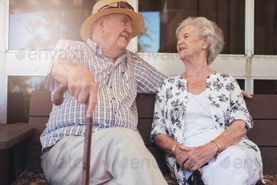 Happy retired couple having a break