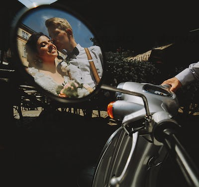 bride and groom in the mirror reflection