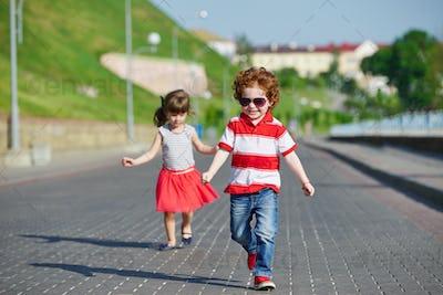 happy children running on the promenade