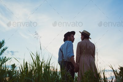Young couple in love in the meadow