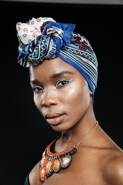 Close-up portrait of a beautiful african woman wearing shawl