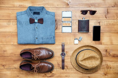 Travel concept shoes, shirt, mobile phone, watch, flask, eyeglasses, hat