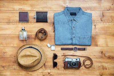 Travel concept shirt, camera, hat, flask, watch, eyeglasses, belt,wallet