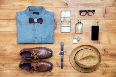 Travel concept shoes, shirt, mobile phone, watch, parfume, eyeglasses, hat