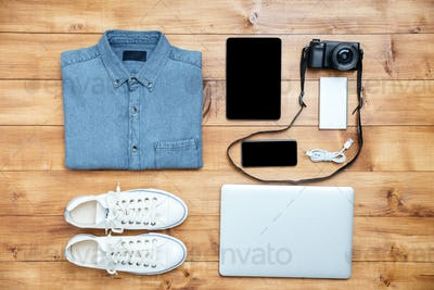 Travel concept shoes, shirt, mobile phone, laptop,mp3, usb, camera