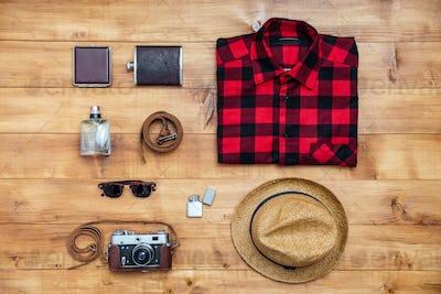 Travel concept shirt, camera, hat, flask, lighter, eyeglasses, belt,wallet