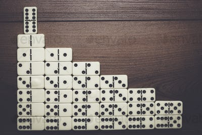 leadership concept domino pieces forming stairs