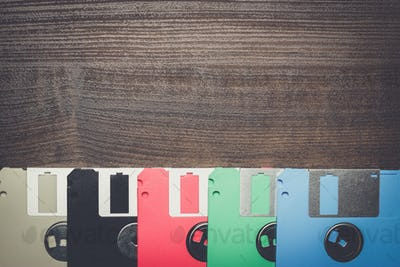 retro technology concept diskette on wooden background