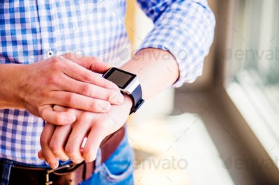 Close up of unrecognizable man using smart watch