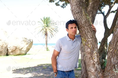Pensive middle aged man standing outdoors