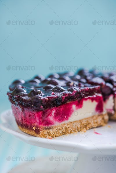 slice of forest fruit cheesecake