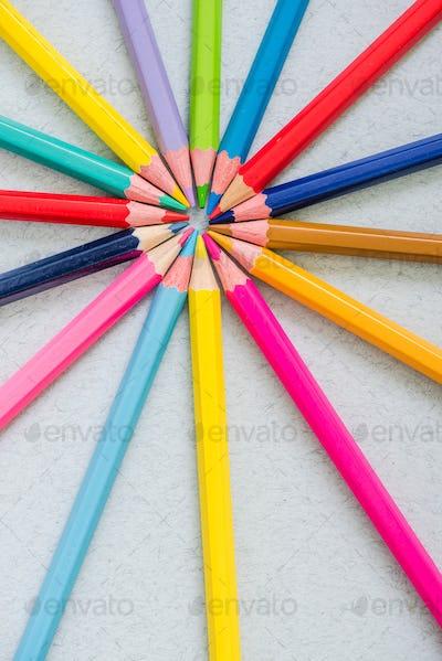 sun burst made of colorful pencils