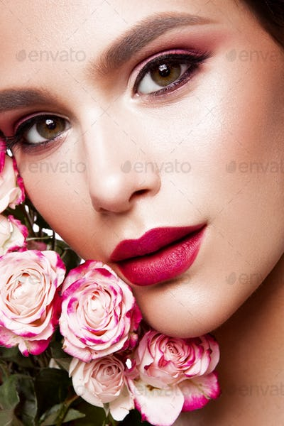 Portrait of young beautiful woman with stylish make-up