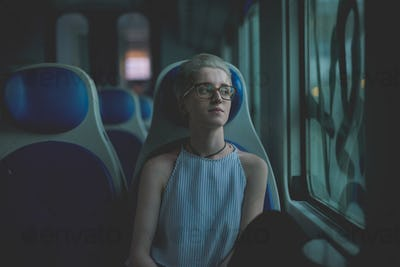 Young beautiful woman sitting on a train