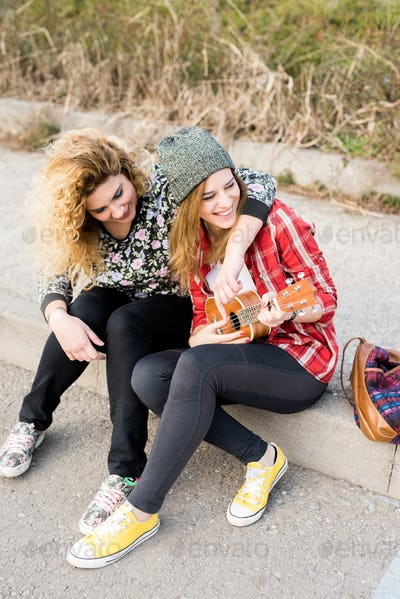 Two young curly and straight blonde hair woman