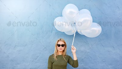 Young beautiful woman with white balloons